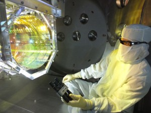 A LIGO technician checks the detector's optics for contaminants by illuminating its mirrors. LIGO